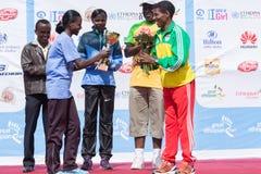 Winnaar van het ras van de 13de vrouwen van de Uitgaven Grote Ethiopische Looppas Royalty-vrije Stock Foto's