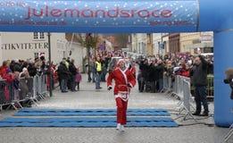 Winner. MIDDELFART - DECEMBER 13: Gitte Karlshoej winner of the Father Christmas Run in Denmark. 5 km Christmas run in Denmark December 13, 2009 in Middelfart Stock Images