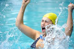 Winner. Pretty swimmer is happy and splashes in the water Royalty Free Stock Photos