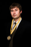Winner. Man in black suit with award Royalty Free Stock Photography