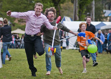 The winner. MARYSVILLE, VICTORIA, AUSTRALIA - November 2: Two men compete for first place in a hobby horse race at the Marysville Sparkling Wine Festival stock photography