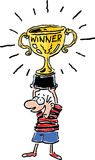 Winner. A boy gets a trophy for getting first place Royalty Free Stock Images