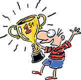 Winner. A boy has won a trophy, and he's happy about it Royalty Free Stock Image