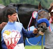 The Winner. PYATIGORSK, RUSSIA - JULY 10:The Winner jockeys Pangokov and bay stallion Proper Redi after winning the Anilina race on June 10, 2011 in Pyatigorsk Stock Images
