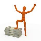Winner. Orange mannequin with stack of money Stock Photo