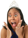 And The Winner IS. Beautiful twenty-something woman in blue pageant dress woman in crown with surprised I won? look on her face.  Wearing wedding ring to Royalty Free Stock Photography