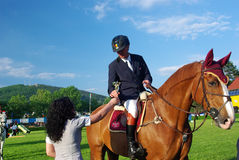 Winner. Receiving his trophy at CSIO2*-W & Balkan Tour, Piatra Neamt (Romania) 4-7 june 2009. Aurel Cojocariu from Romania with his horse Duende Royalty Free Stock Photography