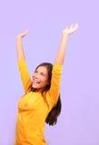 Winner asian woman. Winning successful young woman raising her arms up. Purple background. Beautiful cute mixed race caucasian / chinese young woman model Stock Photo