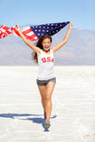 Winner athlete woman with american flag, USA stock photo