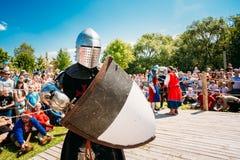 Winner In Battle Knight. MINSK, BELARUS - JULY 19, 2014: Winner In Battle Knight. Historical restoration of knightly fights on VI festival of medieval culture Stock Photos