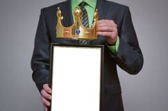 Diploma or certificate. Winner blank diploma or certificate mockup in businessman hand. Man is holding a blank photo frame with copy space for human face and a Stock Image