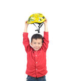 Winner boy with bike helmet. Young, happy biker boy with helmet and looking at camera. Front view. Isolated on white background Royalty Free Stock Images