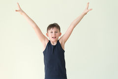 A winner boy. A boy hloding his arms up in victory gesture Royalty Free Stock Photos