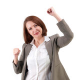 Winner business woman with her hands raised Stock Photo