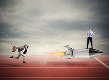 Winner businessman over a fast rocket. Concept of business competition stock photos
