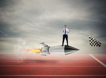 Winner businessman over a fast rocket. Concept of business competition. Winner businessman over a fast rocket against competitor. Concept of business competition Stock Photo