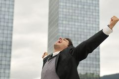 Winner businessman screaming from joy stock images
