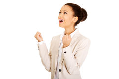 Winner businesswoman celebrating success. African successful businesswoman with hands up Stock Photos