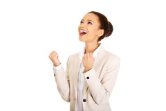 Winner businesswoman celebrating success. Stock Photo