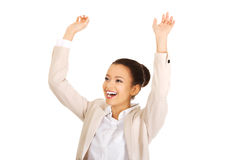 Winner businesswoman celebrating success. African successful businesswoman with hands up Royalty Free Stock Images