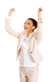 Winner businesswoman celebrating success. African successful businesswoman with hands up Royalty Free Stock Photos