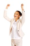 Winner businesswoman celebrating success. African successful businesswoman with hands up Stock Image