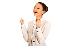 Winner businesswoman celebrating success. African successful businesswoman with hands up Stock Photo