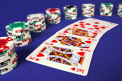Winner cards. There are playing cards and chips in the photo. The background is blue Royalty Free Stock Photo