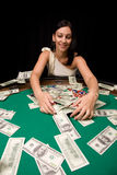 Winner in casino. Pretty caucasian girl wins cash in Vegas casino stock images