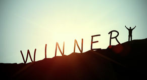 Winner. Concept with words and a man cheering on the moutain Stock Images