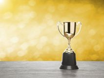 Winner cup with gold bokeh background. Stock Photography