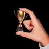 Winner cup in hands. High resolution. 3D render stock image