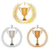 Winner cup trophies set with laurel wreath. Royalty Free Stock Photo