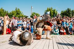 Winner And Defeated In Battle Knight Tries To Get. MINSK, BELARUS - JULY 19, 2014 Historical restoration of knightly fights on VI festival of medieval culture Stock Photo