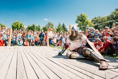 Winner And Defeated In Battle Knight Tries To Get. MINSK, BELARUS - JULY 19, 2014 Historical restoration of knightly fights on VI festival of medieval culture Stock Photography