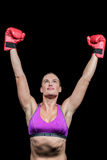 Winner female boxer with arms raised Royalty Free Stock Photos