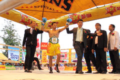 Winner fight PABA Super Flyweight Champion. SURAT THANI, THAILAND - DECEMBER 14 : Norasing Kokietgym wins over Michael Escobia after fight for PABA Super royalty free stock image