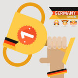 The winner first prize on the hand with germany flag. Vector Stock Photography