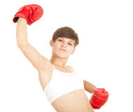 Winner girl in boxing gloves. Winner young woman with red boxing gloves Stock Photo