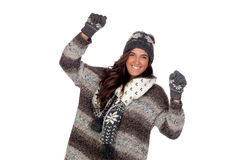 Winner girl dressed in winter clothing. Isolated on a over white Royalty Free Stock Photography