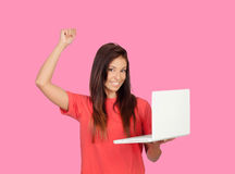 Winner girl with a laptop Stock Photos