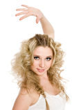 Winner girl with a raised hand. Cheerful young blond girl in a white t-shirt with a raised hand Royalty Free Stock Images