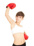 Winner girl in red boxing gloves. Winner young woman in red boxing gloves Stock Photo