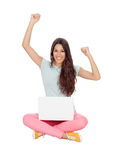 Winner girl sitting on the floor with a laptop. Isolated on white background Royalty Free Stock Photography
