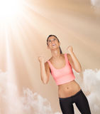 Winner girl with sports clothes on a wonderful sky Royalty Free Stock Images