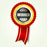 Winner golden icon with red ribbon Royalty Free Stock Image