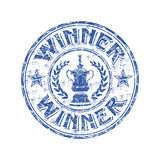 Winner grunge rubber stamp. Blue grunge rubber stamp with winner cup and the word winner written inside the stamp Stock Photography