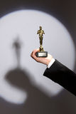 Oscar award in hand Royalty Free Stock Images