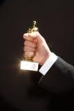 Oscar award in hand Royalty Free Stock Image