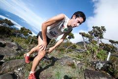 Winner Killian Burgada in Mt Kinabalu CLimbathon. MT KINABALU, SABAH - OCT 25:  Winner of the event, Kilian Jornet Burgada from Spain climbing up Mt Kinabalu in Royalty Free Stock Images